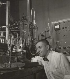 Irving Shain working in a chemistry laboratory.