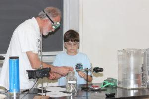 Professor John Moore and student volunteer