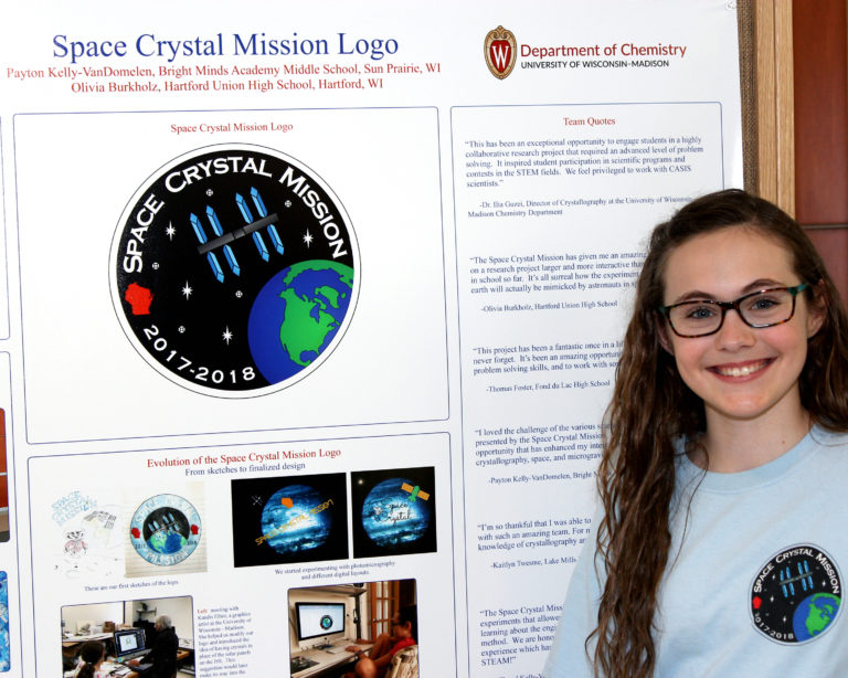 Payton Kelly-VanDomelen, winner of the 2017 space crystal contest, presents her poster at the 2018 awards ceremony. Photo by Tatum Lyles Flick.