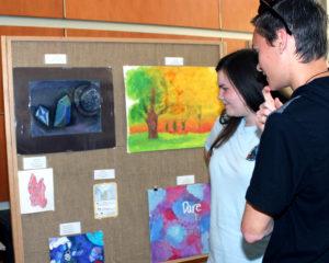 Students discuss artwork
