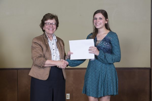 Tess Carlson receives a Hilldale Research Fellowship from Chancellor Rebecca Blank at the Chancellor's Award Ceremony in Spring 2018.