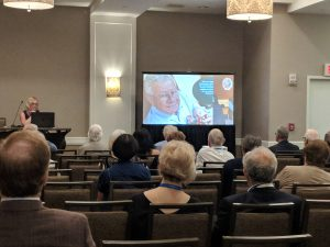 A commemorative slideshow was created for the occasion; here, the screen shows Bassam holding his newborn granddaughter Violet Noor Morrow.