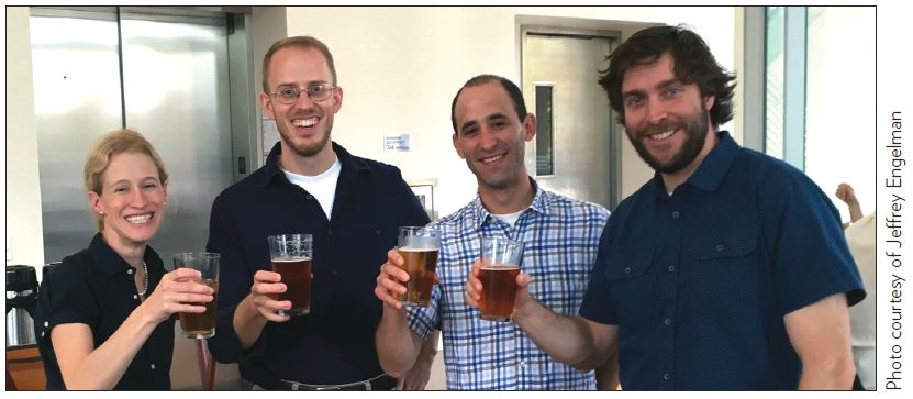 Ph.D. chemists Katie Brenner, Andrew Buller, Jeffrey Endelman and Philip Romero celebrate their mentor's success, after learning that Frances Arnold received the 2018 Nobel Prize in Chemistry.
