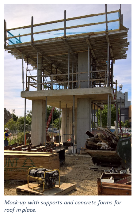 A tower rises above the construction site