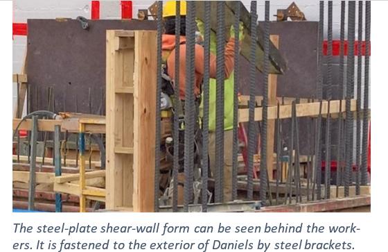 Man working behind steel wall
