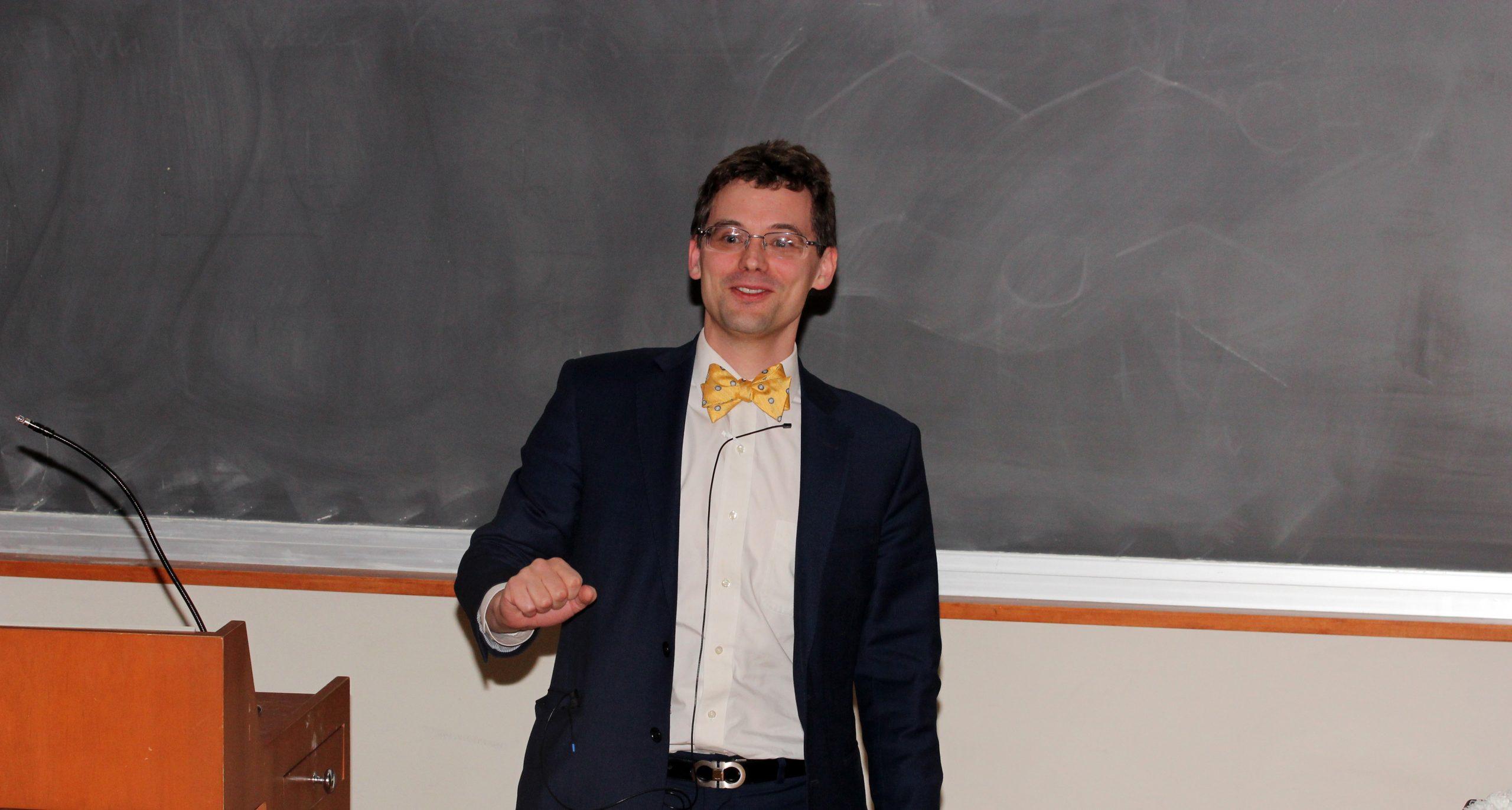 Professor in front of chalk board