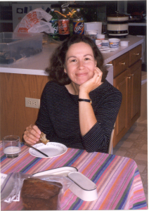 woman with chin in hand, smiling