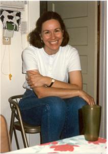 woman in white shirt, smiling