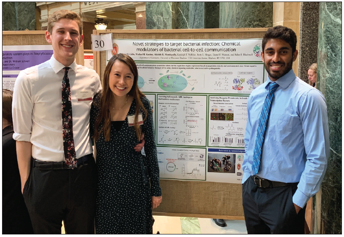 group of students presenting research poster